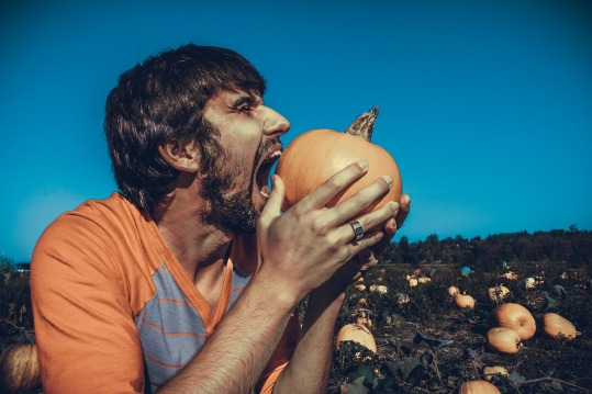 Man Eating Pumpkin